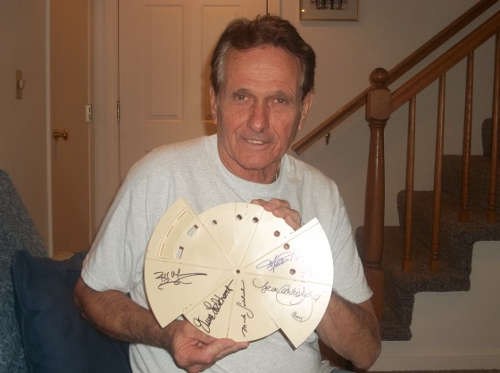 Mark Goddard -- completed autographs of crew members on the flight deck from a Jupiter 2 model.